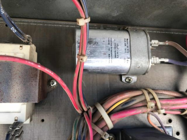 Fresno, CA - A cash advance chain in Fresno, California, store reported no cold air when AC turns on. Tech inspected the 5 ton Trane unit and found a bad condenser fan motor run capacitor, which was failing and causing fan motor to cut out at hottest times of day. Had part stock available, replaced and tested unit. Back up and running, space temp dropping.