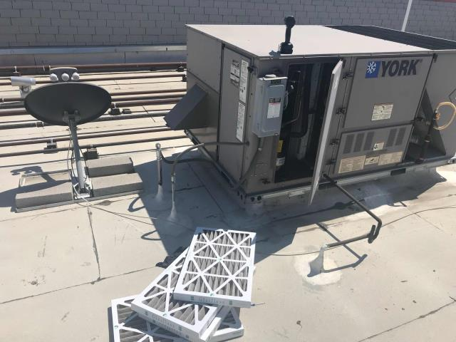 Bakersfield, CA - AC Preventative Maintenance scheduled for a jewelry store in Bakersfield, California. Standard service, unit filters were replaced, all components checked. Note: site needs to keep ladder access key onsite, laying a ladder on the building side is unsafe for this particular location.