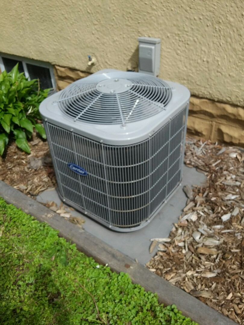 Minneapolis, MN - Just completed a clean and tune on a Carrier air conditioner in Minneapolis