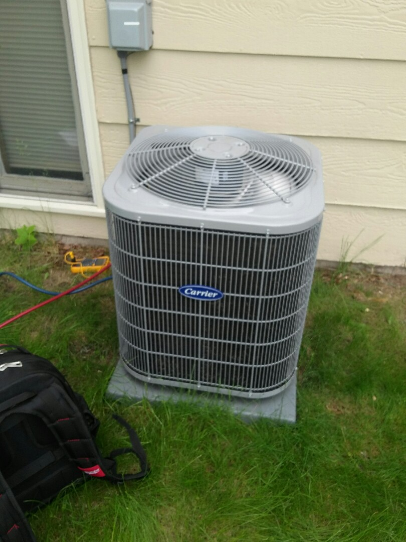 Minneapolis, MN - Working on a clean and tune on a Carrier furnace with a Carrier air conditioner in Brooklyn Park