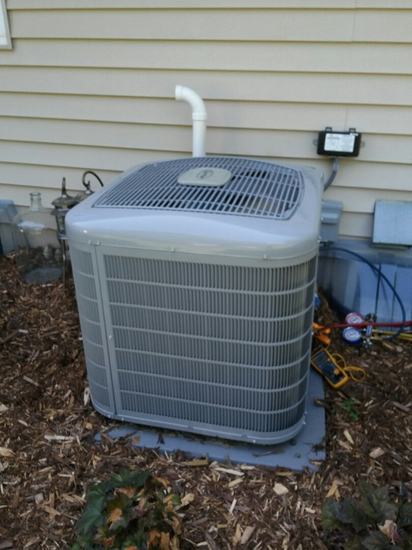 Fridley, MN - working on a clean and tune on a Carrier furnace with a Carrier air conditioner in Fridley