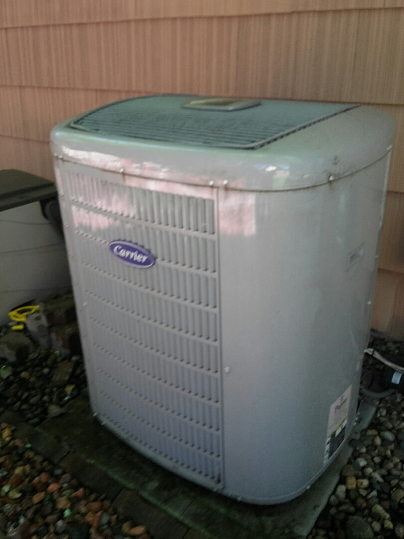 Lakeville, MN - working on a clean and tune on a Carrier furnace with a Carrier air conditioner in Minnetonka