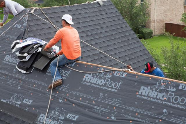 The Woodlands, TX - Working on a new roof replacement, installing GAF Timberline shingles.
