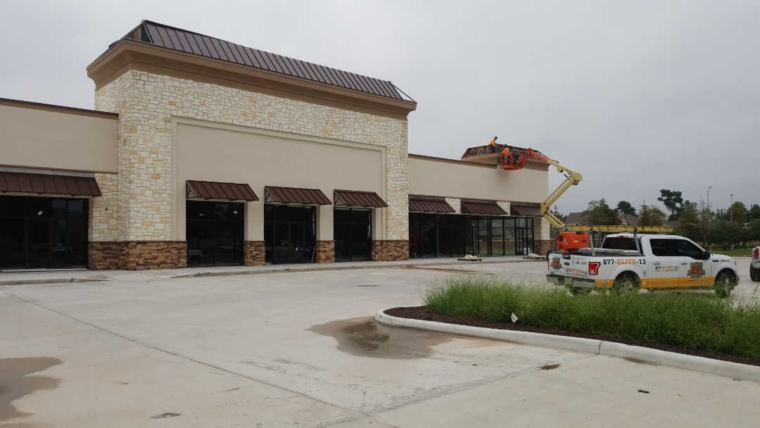 Tomball, TX - Working on the standing seam awnings in Tomball TX.