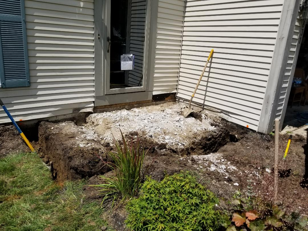 Farmington Hills, MI - New exterior home make over starting.  First phase new porch footing brick and concrete