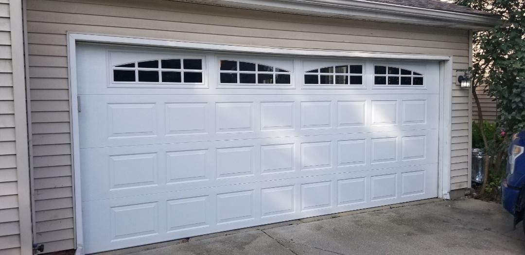 Royal Oak, MI - Complete exterior remodel in progress Royal Oak.  New insulated garage door with windows a Liftmaster garage door operator