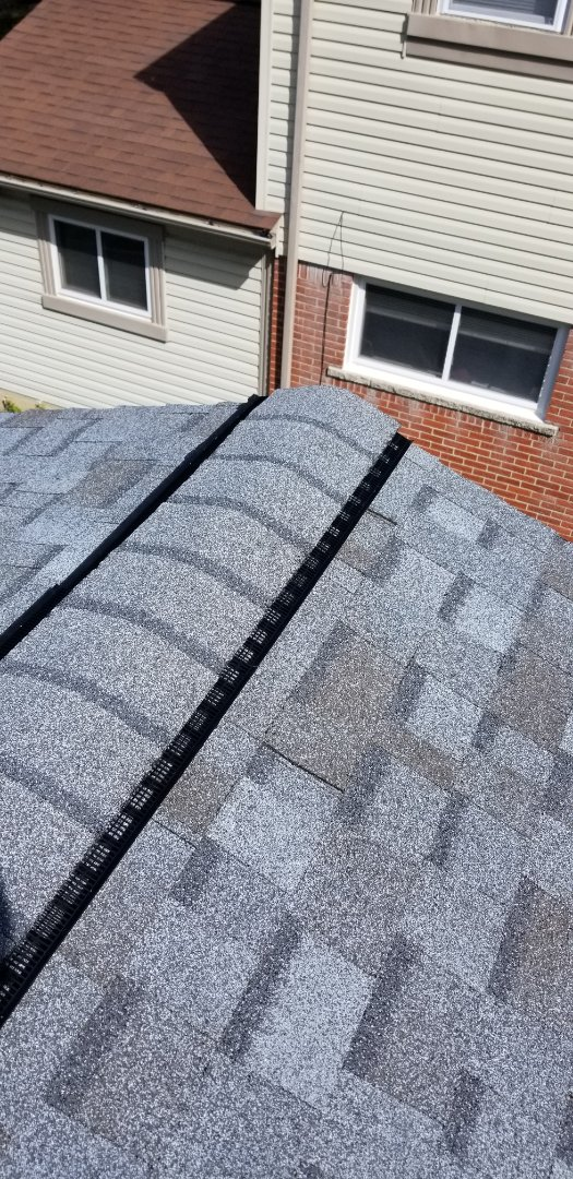 Livonia, MI - Complete roofing system including replace all roof decking,  Owens Corning Duration Quarry Gray,  OC  Pro Armor Synthetic underlayment,  Ice guard, attic ventilation with insulation baffles, Fascia Vent,  OC VentSure Ridge Vent Pro, New custom chimney flashing system.  Text book roofing.