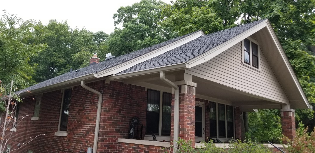 Dearborn, MI - New GAF Timberline High Definition Charcoal roofing,  Solar power roof vent, new brick chimney and flashing system.  Six inch seamless gutters,  down spouts with Sureflow gutter protection on 1920's Dearborn Bungalow