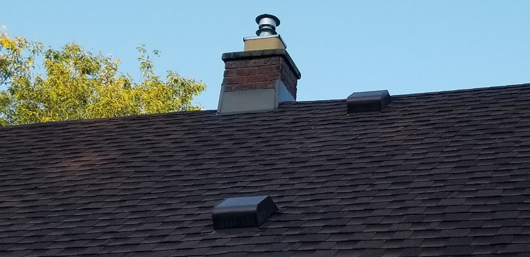 Dearborn, MI - Roofing system tune up, Dearborn.  new custom chimney flashing. Roof vents, roofing repairs completed before the weather changes.