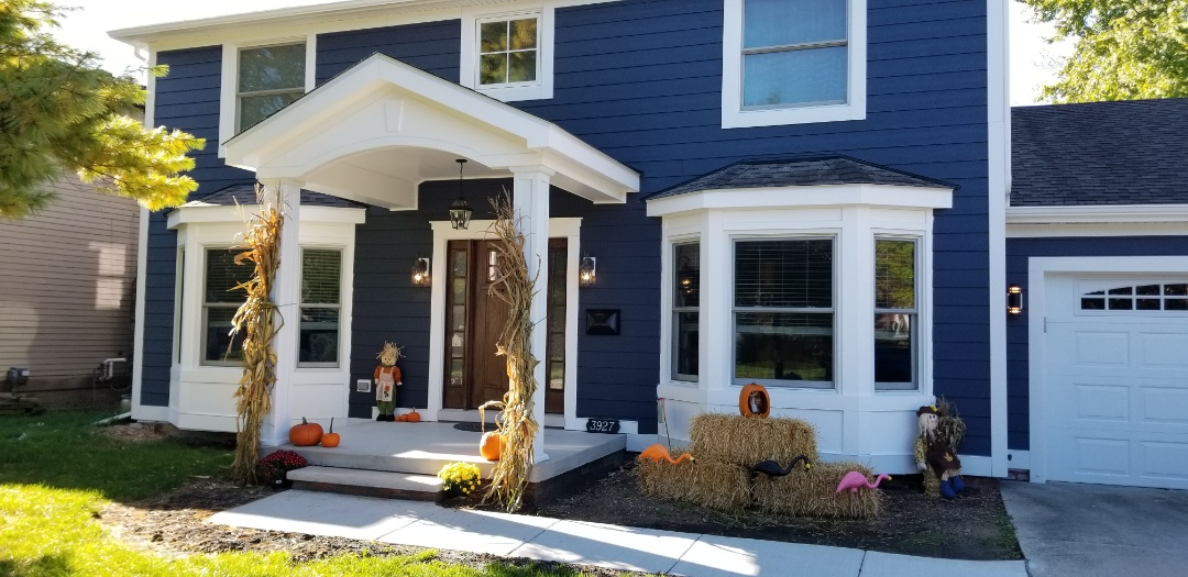 Royal Oak, MI - JAMES HARDIE SIDING,  custom front masonry porch, Andersen windows, THERM TRU fiberglass entry door, Custom front porch overhang.  This was my favorite project this year