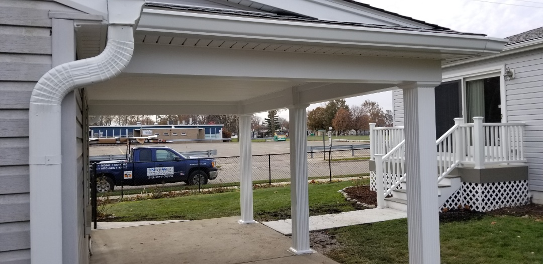 Dearborn, MI - Back yard covered patio including wood frame Construction, Certainteed Landmark roofing, aluminum trim, Certainteed vinyl porch cieling, Afco load bearing aluminum columns,  six inch seamless gutter system in Dearborn