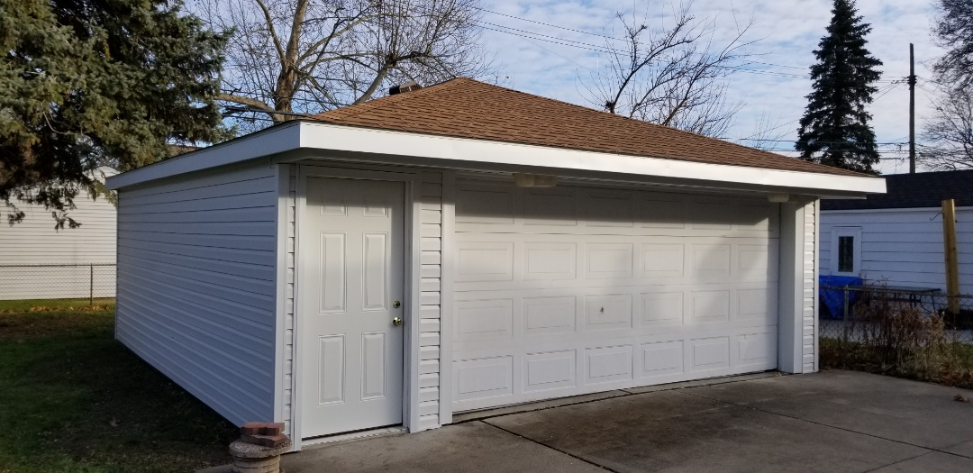 Allen Park, MI - New Certainteed Vinyl siding on the garage in Allen Park including Ceramic Perimeter vinyl soffits,  new aluminum trim and a new 36 inch raised panel steel entry door