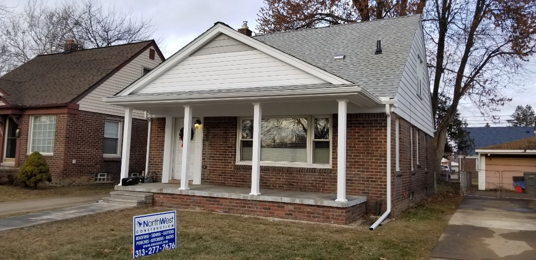Dearborn, MI - New gable style front porch overhang in Dearborn, including GAF Timberline High Definition roofing (Fox Hollow Grey), Certainteed vinyl siding with Cedar Impressions Shake style siding, new aluminum trim, Seamless Gutters with Sureflow gutter protection,  New Afco Square Fluted aluminum columns.
