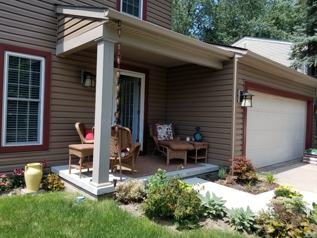 Farmington Hills, MI - Beautiful front porch with new porch overhang Certainteed MONOGRAM siding seamless gutters with Sureflow gutter protection and a rain chain