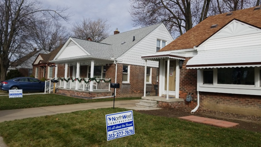Dearborn, MI - New front porch overhang at one house,  New Aluminum awnings at front porch and front picture window