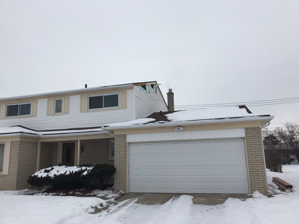 Southfield, MI - Completing a siding repair in Southfield today.