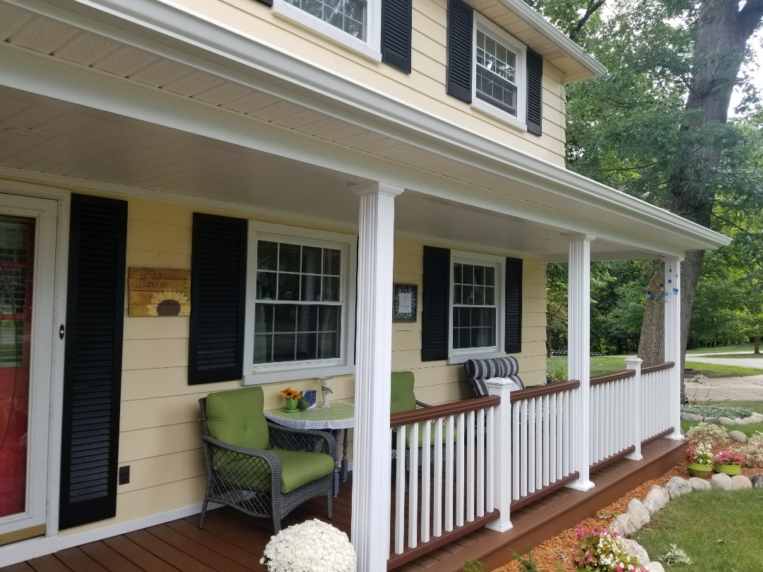Livonia, MI - Long Live The Porch  New custom porch and porch overhang featuring TREX Transend porch floor with load bearing AFCO aluminum columns and TREX Transend railing in Firepit and white. Outdoor living