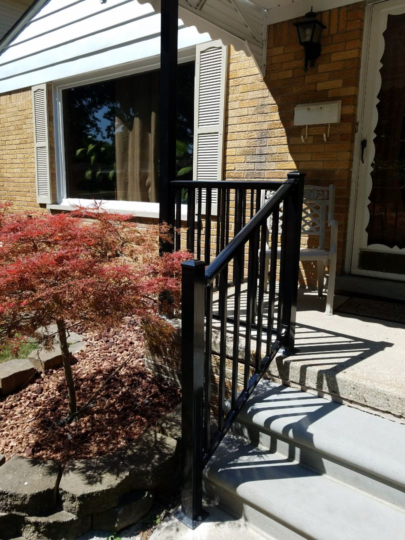 Dearborn Heights, MI - New heavy duty aluminum porch and steps railing with three inch awning supports, R-4000 series with black powder coat finish for  many years of maintenance free service, looks great