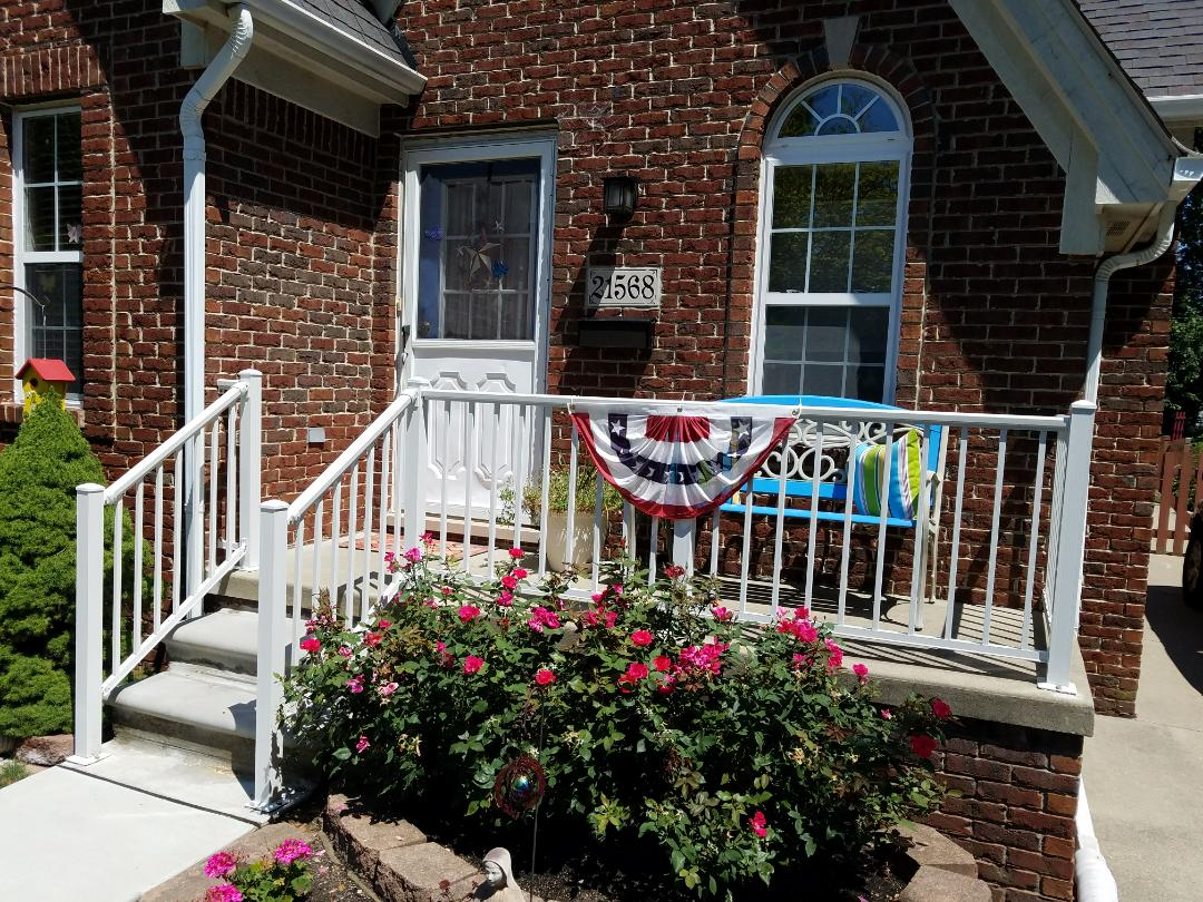 Dearborn, MI - New Heavy Duty aluminum porch and steps railing with white powder coat finish (R-4000 series)  including new precast concrete steps with new step footing, strong and safe.