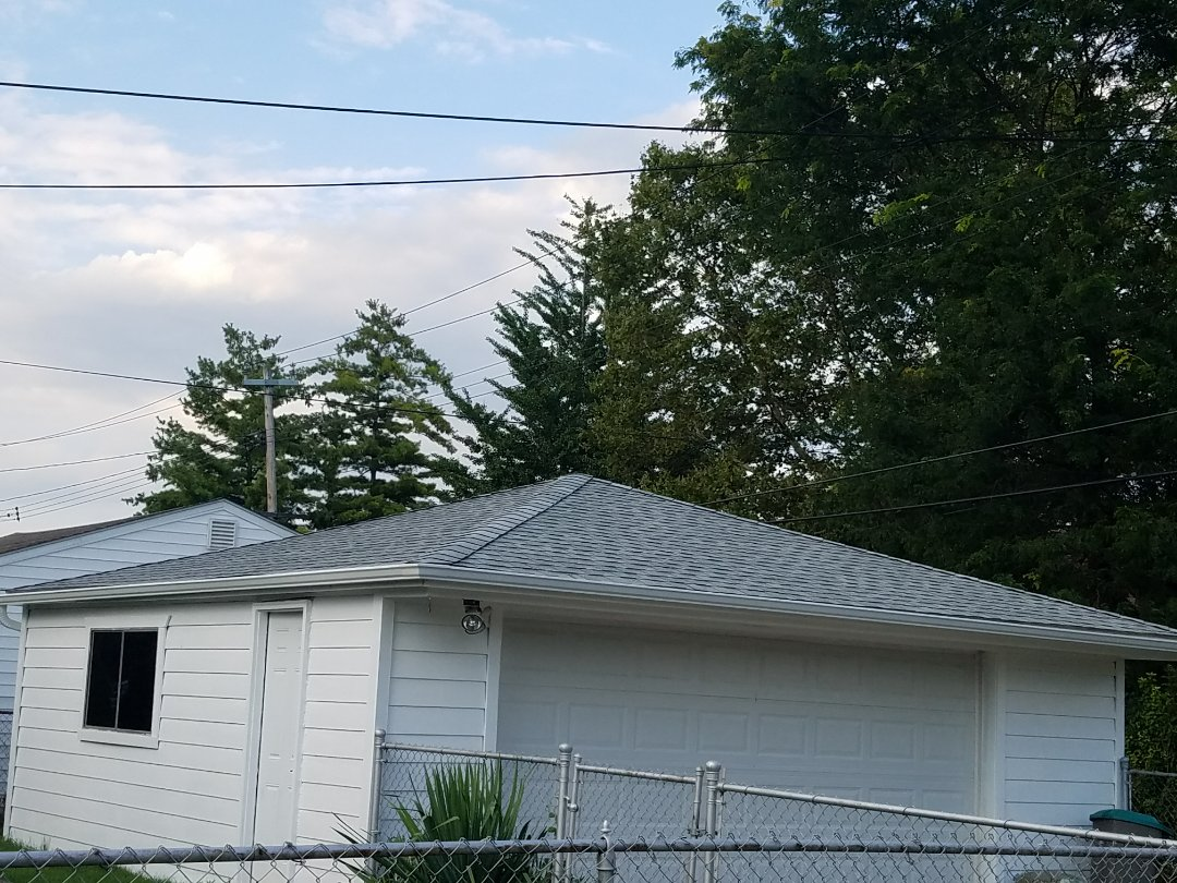 Dearborn, MI - GAF Timberline High Definition, Birchwood,roofing with Timber Tex ridge cap shingles and new aluminum seamless gutters.