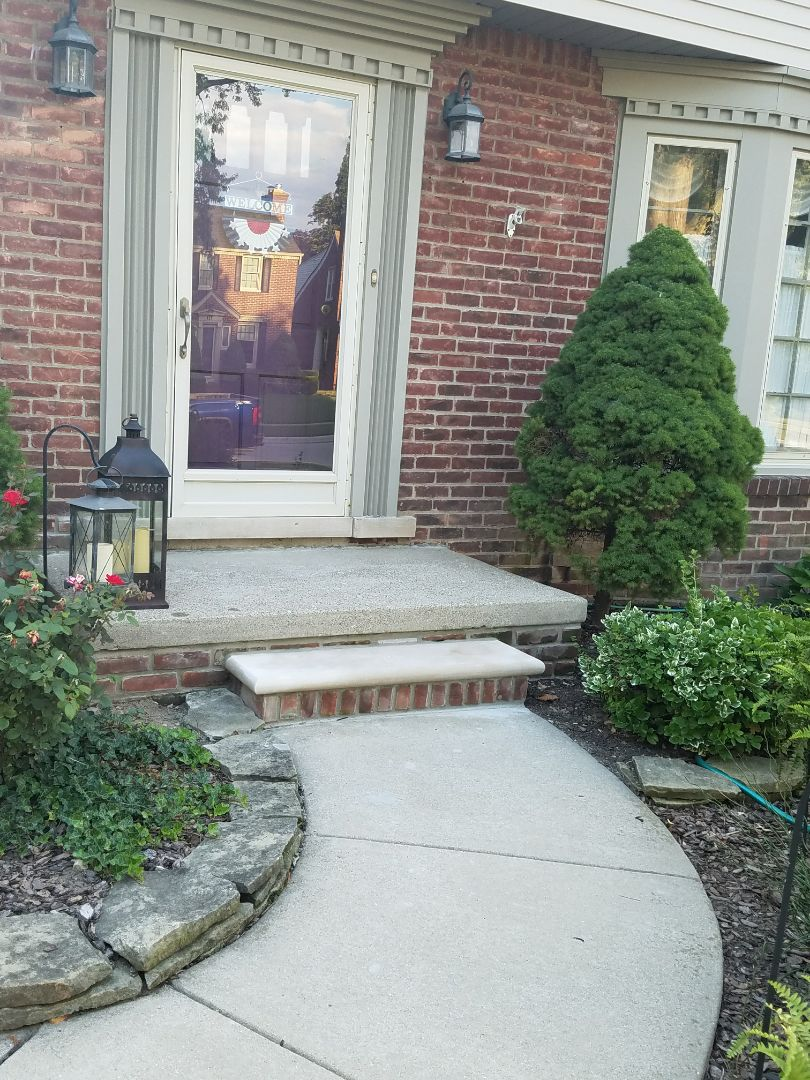 Dearborn, MI - repair vs replace..Porch repairs, save concrete porch cap install common brick with new brick and limestone step,  ready for more years of service without the expense of a complete front porch replacement.