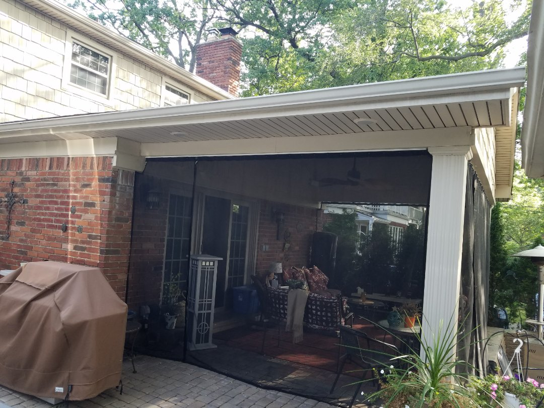 "Dearborn, MI - Outdoor Living Space21'X13' brick patio covered by a classic gable style overhang supported by two 12"" Afco Collumms, Certainteed Cedar Impressions siding Gaf Timberline roofing beaded porch cieling vaulted with recessed lighting and fan"