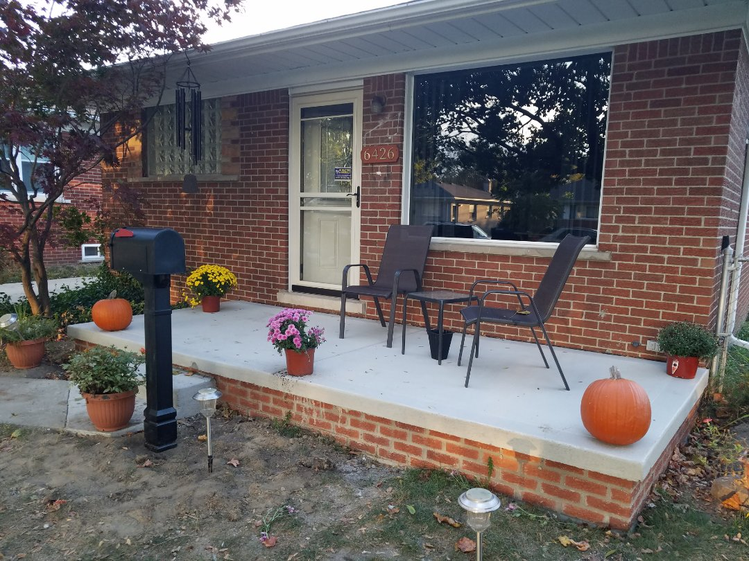 "New Front porch with reinforced concrete porch cap and a 48"" solid concrete step, and new brick on a 42 "" footing in a usable size, 16 feet wide and a 6 foot projection. enough space to enjoy your morning coffee."
