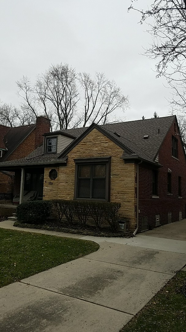 Dearborn, MI - GAF Timberline High Definition roofing, Mission Brown, GAF TPO low slope roofing at former and commercial six inch gutters with sure flow gutter protection