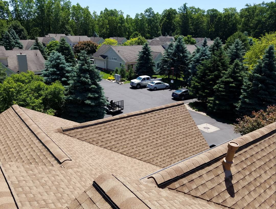 Westland, MI - Roofing, GAF Timberline High Definition, Shakewood with Timber Tex ridge cap shingles GAF Snow Country Advanced ridge vent, including attic insulation baffles to improve the ventilation system at Maplehurst Condominiums, a beautiful well maintained community.
