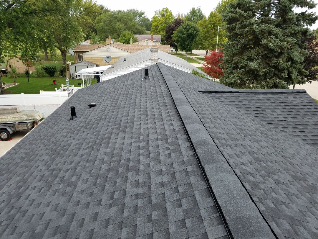 Trenton, MI - GAF Timberline HD Charcoal roofing system with proper attic ventilation, Broan roof cap and ductwork for bath fan, new chimney flashing system, including the GAF Golden Pledge Lifetime Warranty. nice looking roof.