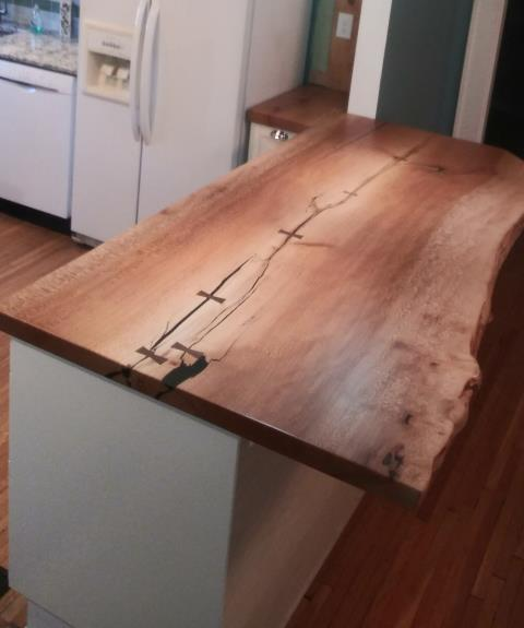 """Columbus, OH - In this smaller kitchen modification, our client wanted to remove a wall in order to open up the kitchen to the rest of the house.  They replaced the wall with a bank of lower cabinets topped with this beautiful """"live edge"""" countertop."""