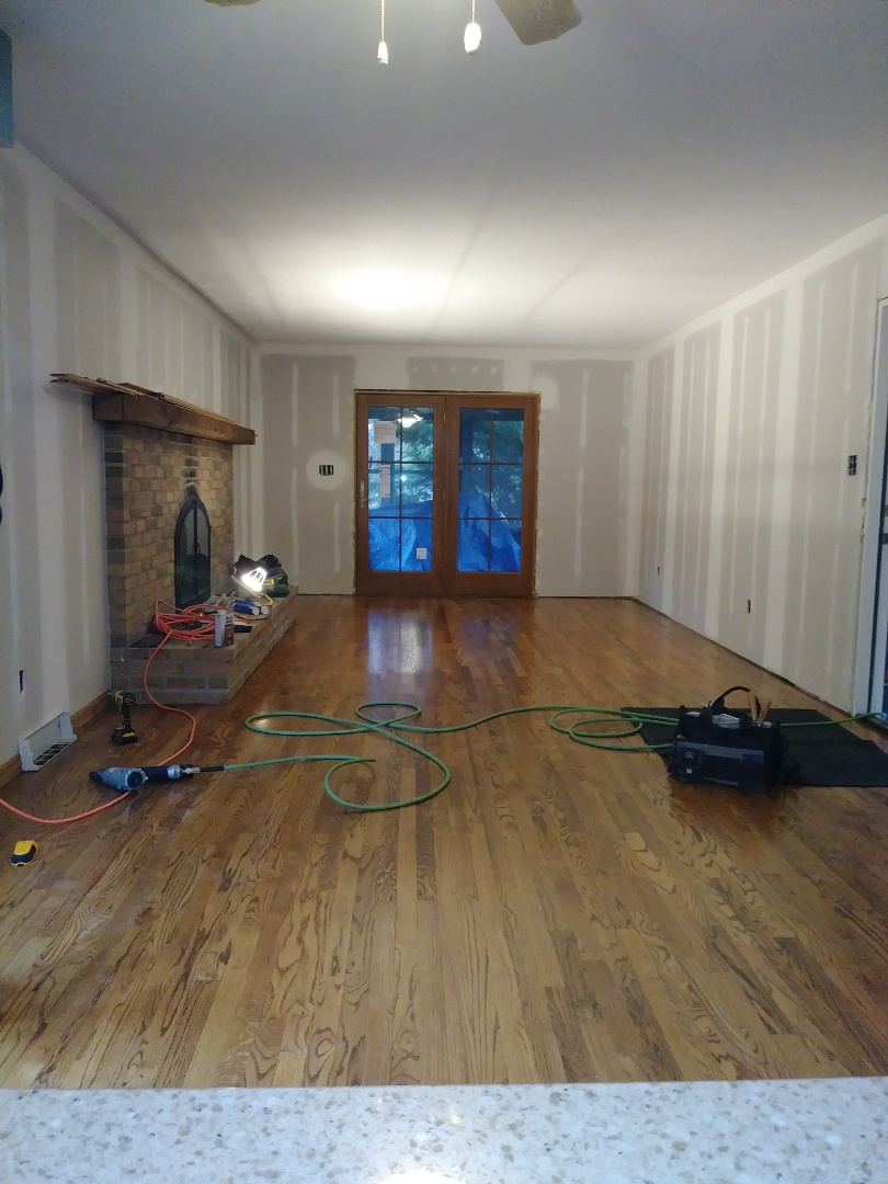 Columbus, OH - Time to trim out the fresh living room up with custom mantle and newly finished hardwood floor and new French doors