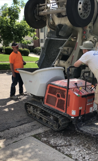 Columbus, OH - Pouring the foundation footings on this two-story addition project in Clintonville.  Using the concrete buggy allows us to move a large volume of concrete with less impact on the client's property.