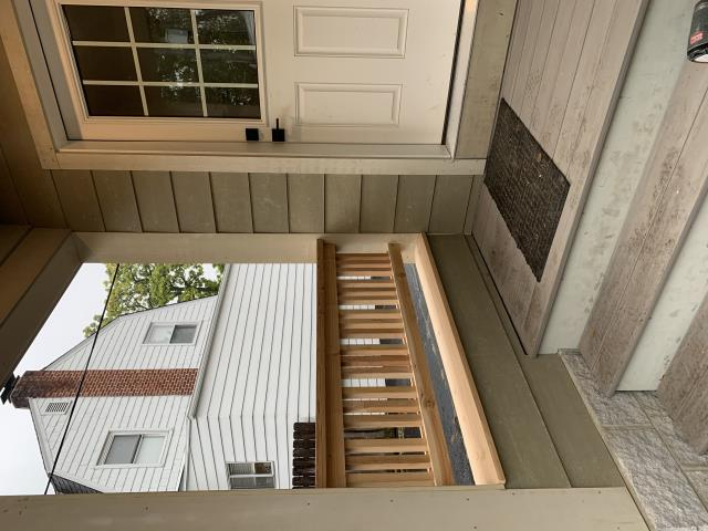 Columbus, OH - This covered rear entry leading into our Clintonville addition project is coming along nicely.  Thanks to durable, long-lasting products, this exterior entry will continue to look good for decades to come!  Steps and landing are Timbertech composite decking, siding is HardiePlank, the railing is made from naturally weather-resistant cedar and trim work is comprised of Boral composite material.