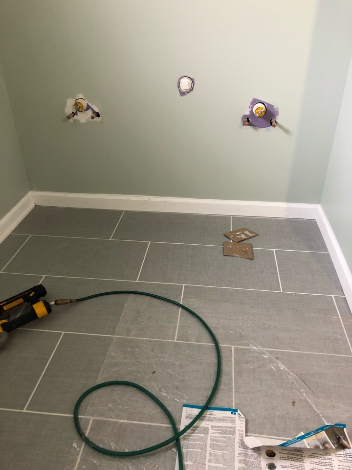 Worthington, OH - A new large format tile floor with Bright White grout makes a clean fresh statement in a new bathroom