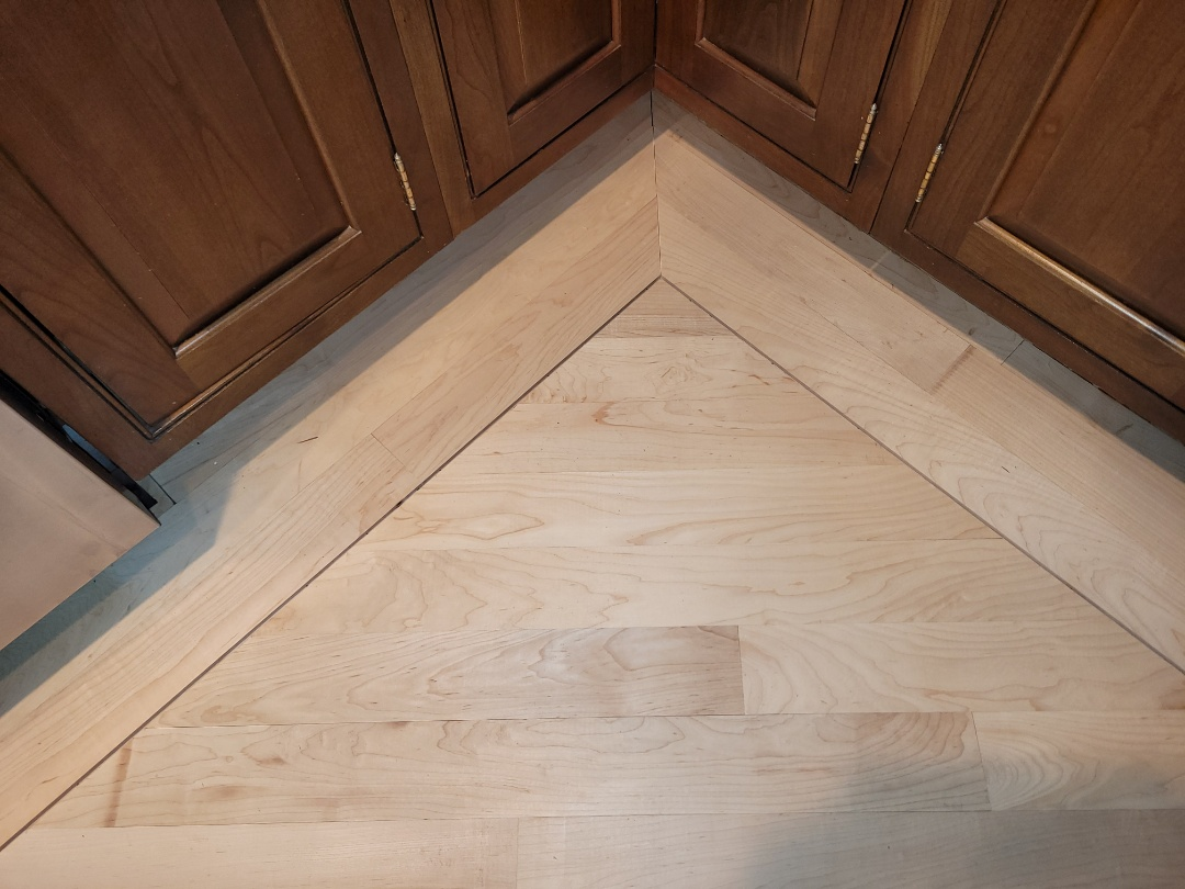 Worthington, OH - New hardwood floor finished in place, with a border and detail line for accent
