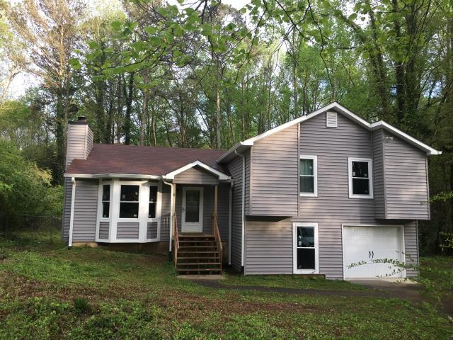 Douglasville, GA - Chimney cap, gutters and siding/window replacement completed in Douglasville.