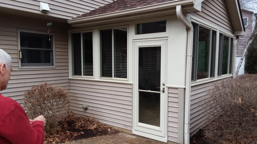 Bristol, WI - 7 windows and a storm door
