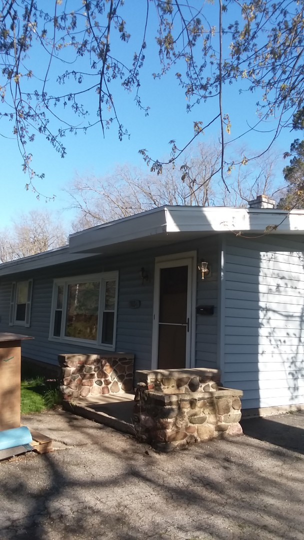 Hales Corners, WI - Installing fascia and gutters on ranch style house