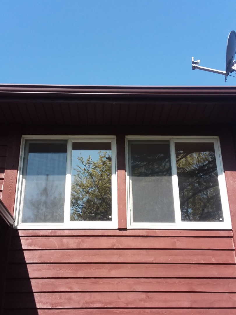 Pewaukee, WI - Twelve windows full frame  install with woodwork and aluminum trim