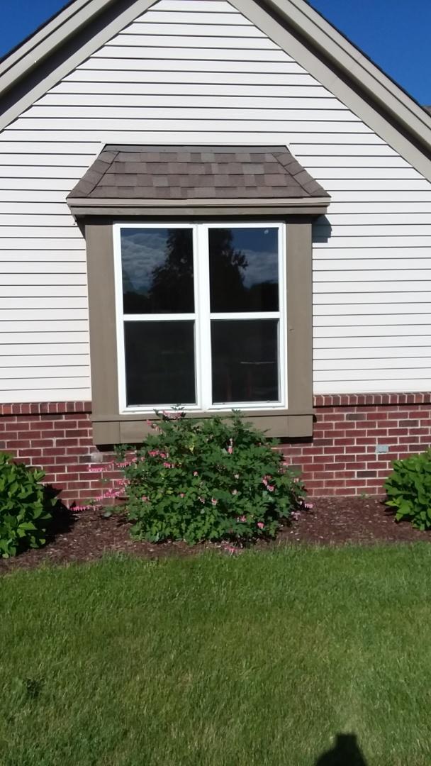 Burlington, WI - Eleven windows pocket install with stops and sliding patio door