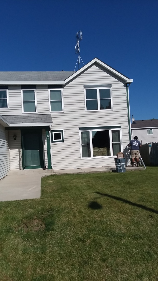 Kenosha, WI - Installed 14 windows and 1 patio door