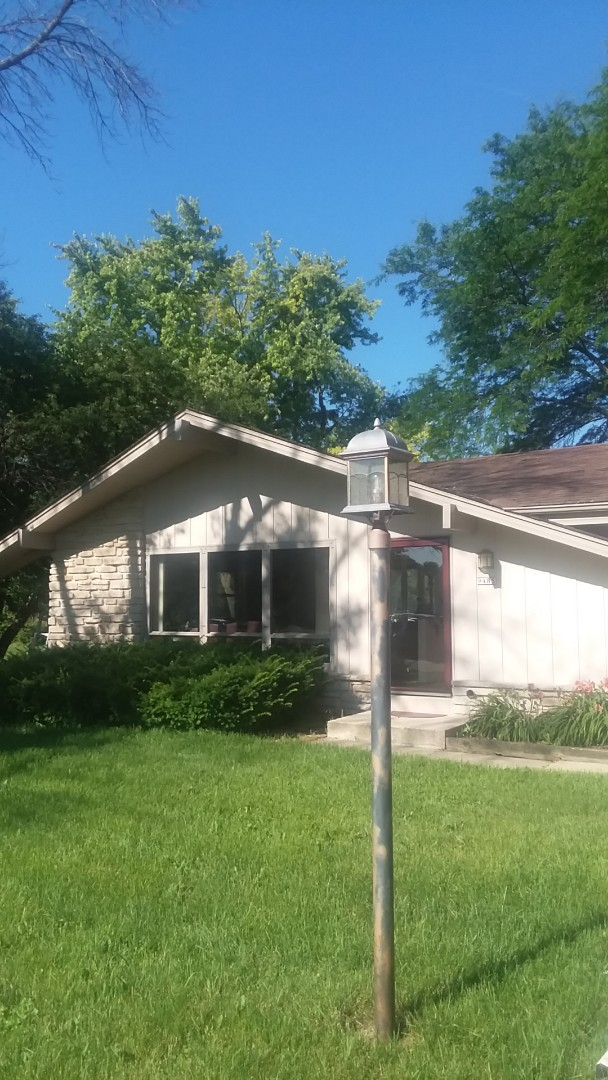 Brown Deer, WI - Installing gutters on ranch style house