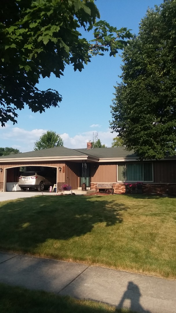 Franklin, WI - Beginning year of vinyl siding and brick on ranch style home