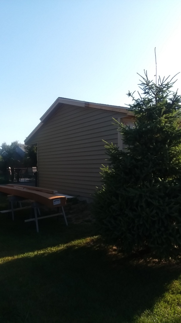 New Berlin, WI - Continuing installing siding and soffit and fascia  on addition of ranch style house