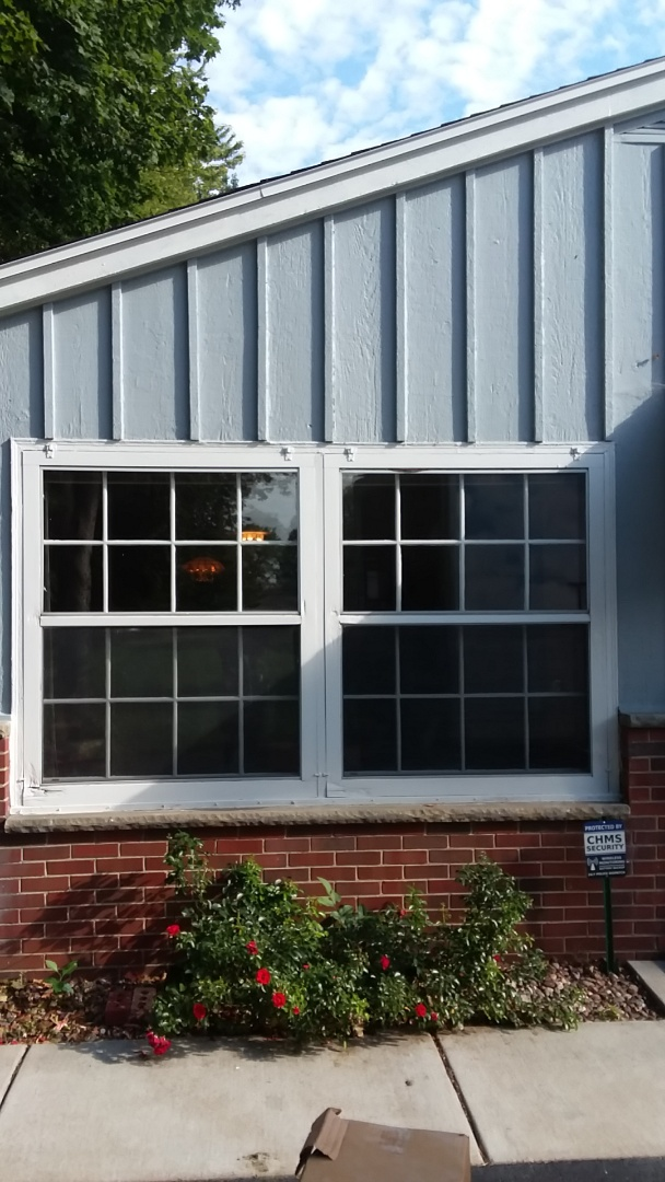 Glendale, WI - Sliding patio door and three windows pocket install with stops and aluminum trim