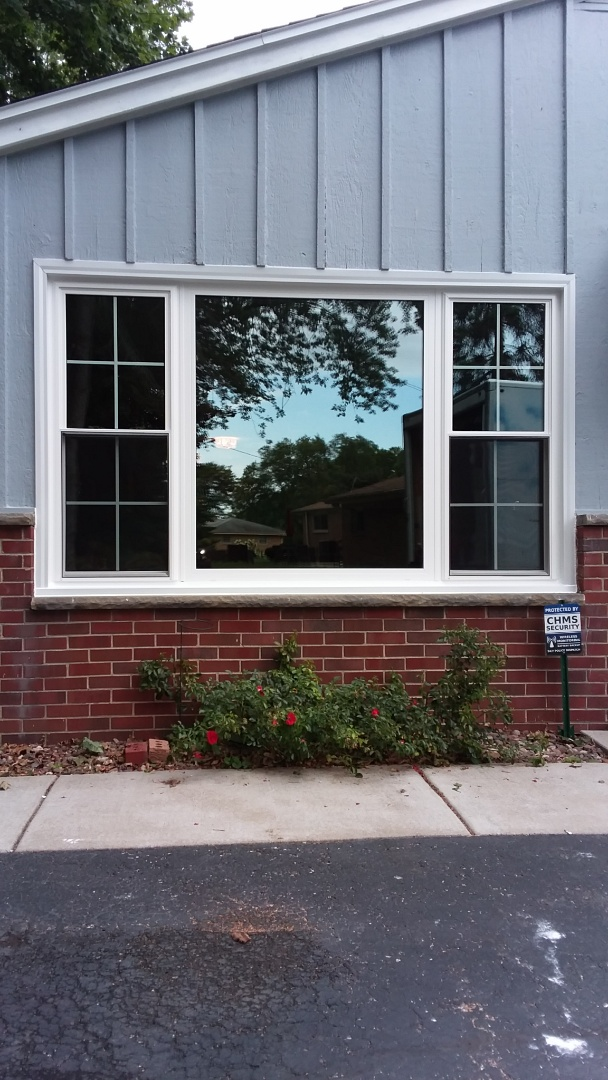 Glendale, WI - Sliding patio door with woodwork and aluminum trim and three windows pocket install