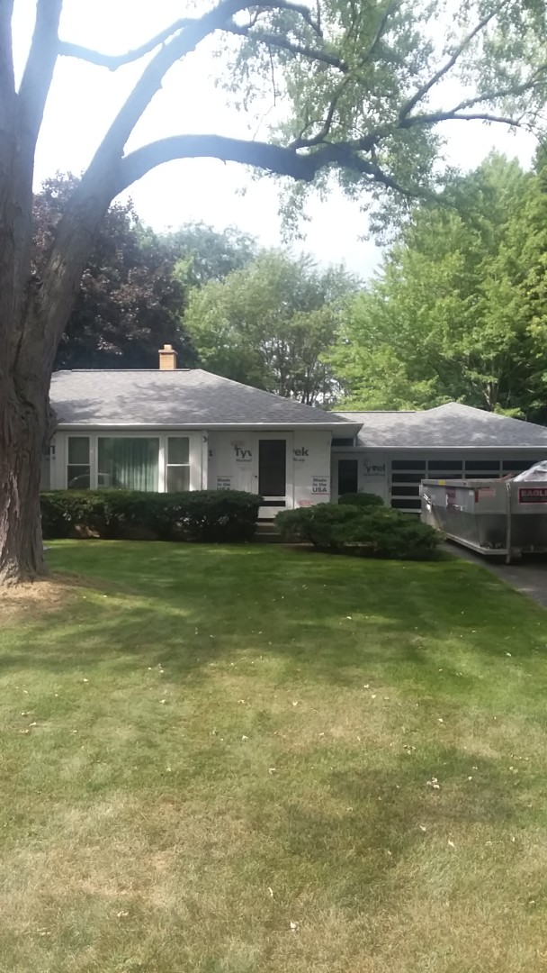 Oconomowoc, WI - Finishing tear off and beginning trimming windows on ranch style home