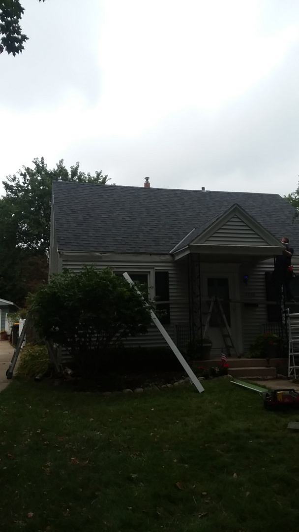 Wauwatosa, WI - Installing gutters on ranch style home