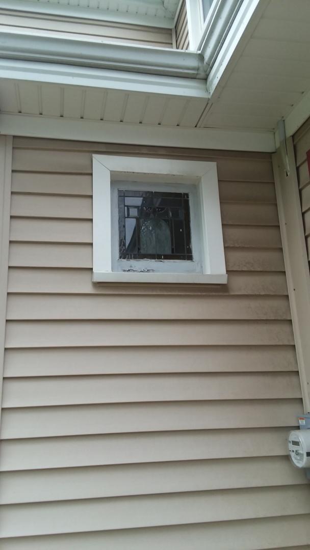 Menomonee Falls, WI - Installing 9 hopper windows and 3 storm windows